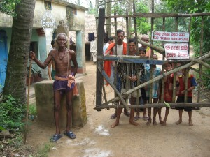 Villagers block entry to Dhinkia village on the Posco site