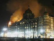 Flames rising from a wing of the Taj hotel - Reuters pic