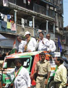 Milind Deora (centre with cap)