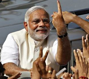 Narendra Modi after casting his vote earlier in Gujarat