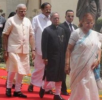 Prime minister Narendra Modi (left) and President Pranab Mukherjee (centre) walk to parliament today