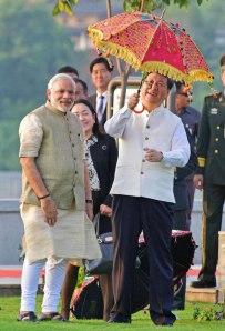 modi-xi umbrella - Indian Express
