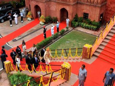 Narendra Modi climbs up to the ramparts of the Red Fort to deliver his speech - pics also above and below