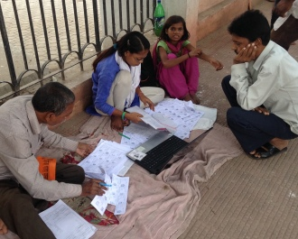 BJP workers checking election lists during Patna's polling day