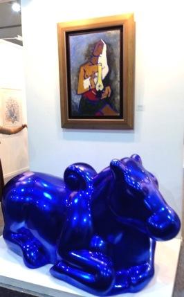 paint-silverleaf fibreglass bull by Arunkumar HG below an M.F.Husain - Crayon Gallery