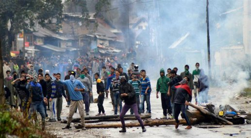 Protesters throw stones at police during clashes - PTI Photo