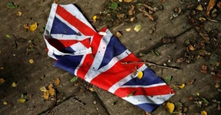 a-british-flag-which-was-washed-away-by-heavy-rains-the-day-before-lies-on-the-street-in-london-june_448171_
