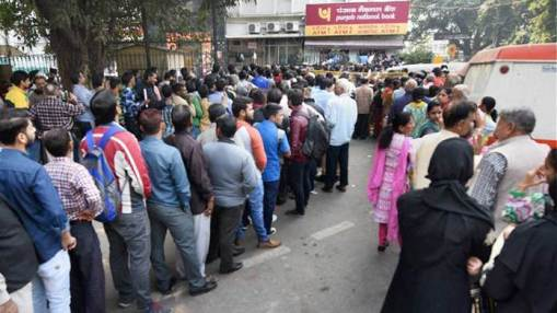 People standing in long queues
