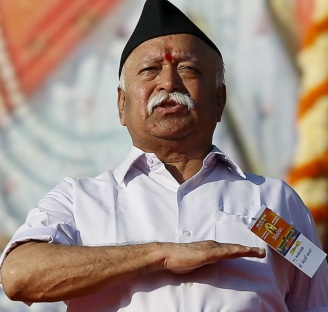 Bhagwat, chief of the Hindu nationalist organisation Rashtriya Swayamsevak Sangh, gestures as he prays during a conclave on the outskirts of Pune