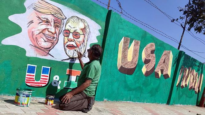 An artist makes graffiti showing a picture of USA President Donald Trump